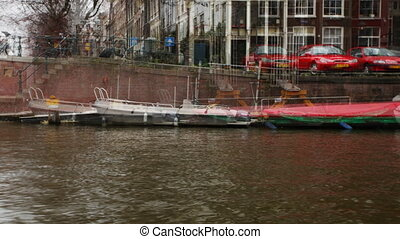 view of amsterdam shot from a canal boat