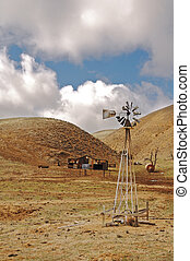 Old farm - Wind driven pump on old run down farm in Central...