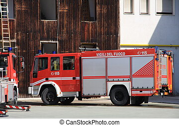 fire truck parked after switching off of a fire