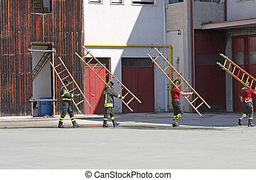 exercise and training of firefighters in the fire station with wooden ladder