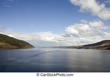 Loch Ness in Scotland with a wake from a boat which could be...
