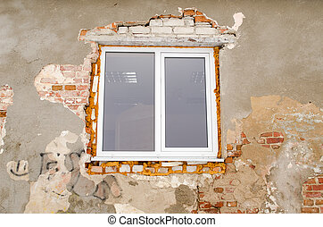 renovation plastic window old brick house wall - new plastic...