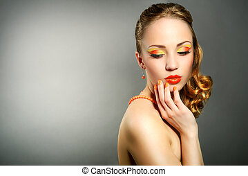Sensual woman with beautiful make-up on gray background