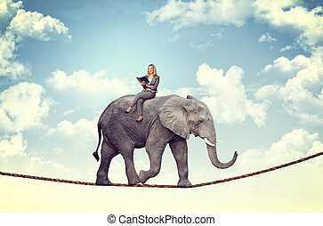easy like read a book - smiling woman on acrobat elephant