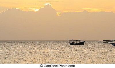 boat saling at the sunse