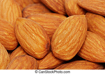 Almond Nuts - Close up of a pile of almond nuts.