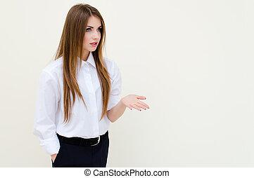 Young business woman wearing man's shirt showing copyspace