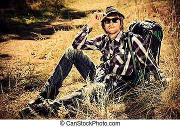 trekker - Handsome young man tourist making his journey at...
