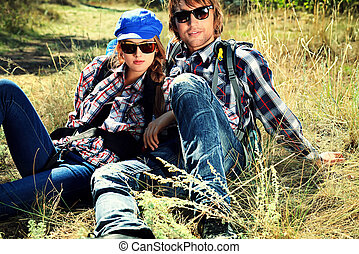 hippie relax - Casual young couple sitting together on a...