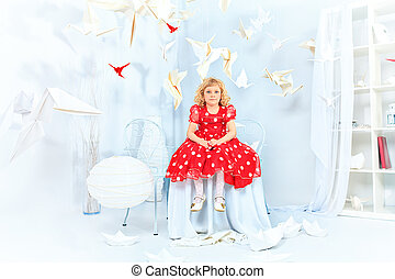 daughter - Cute little girl sitting in a white room...