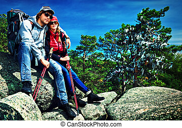 couple tourists - Couple of tourists are sitting at the top...