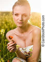 young Woman poppy field at sunset - young Woman in poppy...
