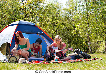 Young teenagers having a nice time on the camping - Young...