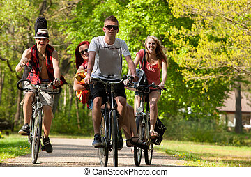 Group of teenagers on bicycles - Young teenagers are making...