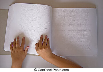 fingers and braille blind people read a book in braille