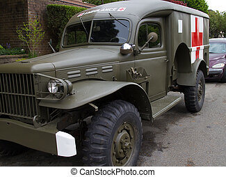 retro military ambulance in neighborhood - a retro military...
