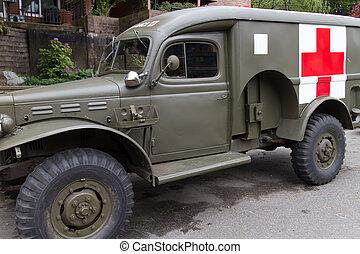 vintage military ambulance in neighborhood