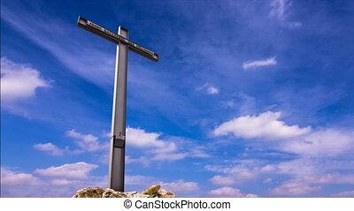 cross against blue sky timelapse