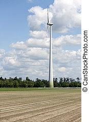 single wind power engine in farm field