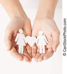 womans hands with paper women - womans hands showing two...