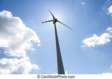 single wind power engine with clouds and sky