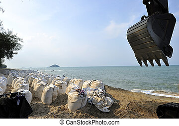 Sand bags along the beach in Songkra to protect from heavy...