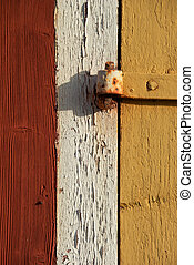 Old hinge - Rusty hinge on yellow old wooden barn door