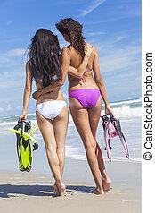 Rear View Beautiful Bikini Women At Beach - Rear view of two...