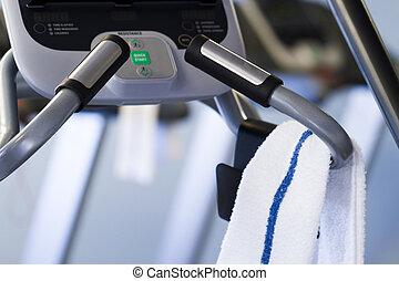 Elliptical machine in a small gym.