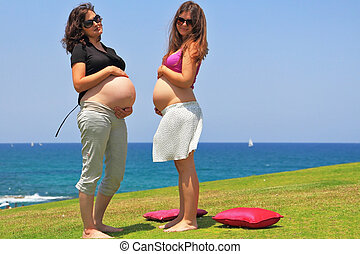 Two young pregnant woman with magnificent hair - Two lovely...
