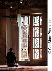 Islamic man praying in mosque - Islamic prayer in Blue...