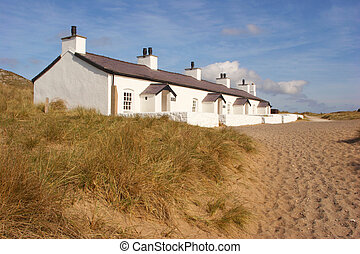 Beach Cottages - These pretty whitewashed beach cottages...