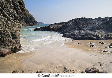 Kynance Cove beach with tide coming in