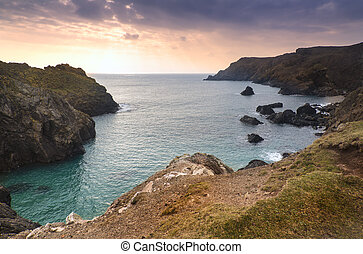 Spring sunset at high tide at Kynance Cove