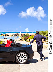 Man With Sport Car On The Beach - Man with black sport car...