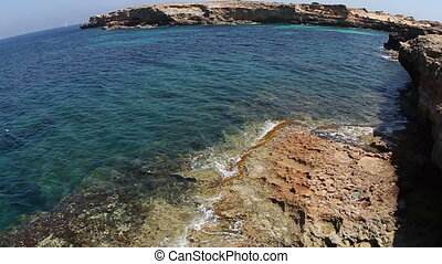 the rugged coastline of the island of formentera, spain