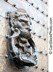 Ancient door knocker in Cordoba, Andalusia Spain