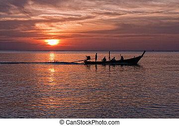 Long tailed boat at sunset, Nai Yang beach, Phuket,...