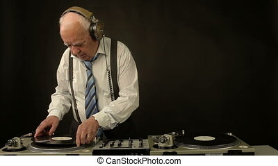 a very funky elderly grandpa dj mixing records
