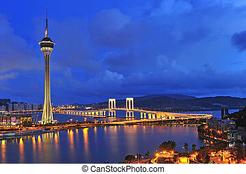 Urban landscape of Macau with famous traveling tower under...