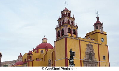timelapse of day turning to night of the iconic yellow church in guanajuato, mexico