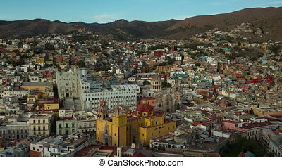 timelapse at dusk of the beautiful guanajuato city skyline, mexico. this city is interesting as most of the roads are underground in tunnels.