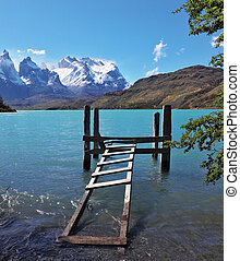 Boat dock on Lake Pehoe. The National Park Torres del Paine,...