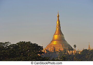 Shwedagon Pagoda Temple with village below in the morning...