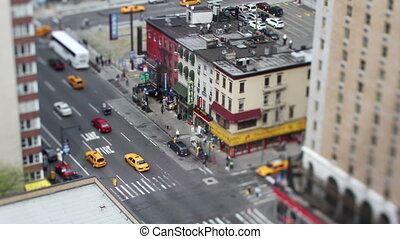 looking down onto a manhattan street scene with traffic and...
