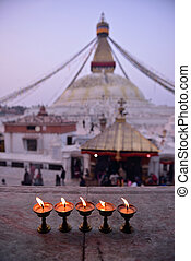 sacred candles in front of Boudha Nath (Bodhnath) stupa in kathmandu, Nepal