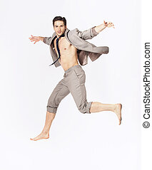 Handsome jumping man on suit isolated on a white background