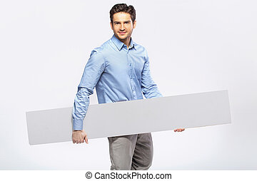 Picture of handsome man in suit with a blank board