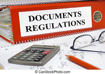 documents and regulations - folder marked with documents and...