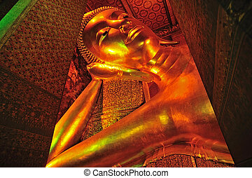 The face of Reclining Buddha statue in Thailand Buddha...